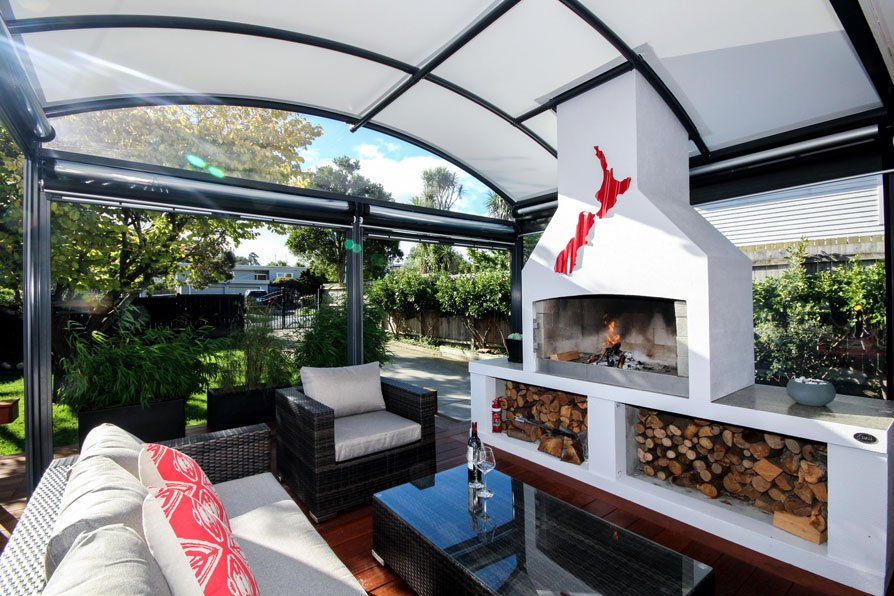 outdoor room with fireplace covered by a fresco canopy